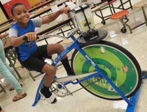 child riding a blender bike
